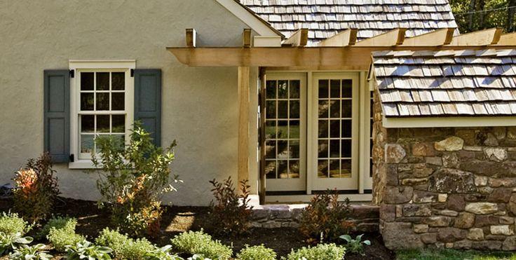 Material combination and color. Beautiful pergola over door.