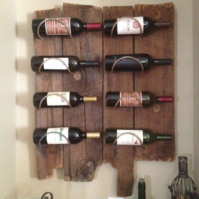 We decided to make our own wine rack from local old barn wood. This is just our style!