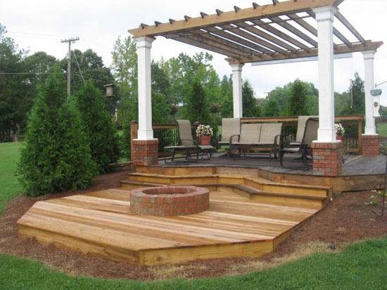 Deck with fire pit.  Not how I'd design but like the idea!