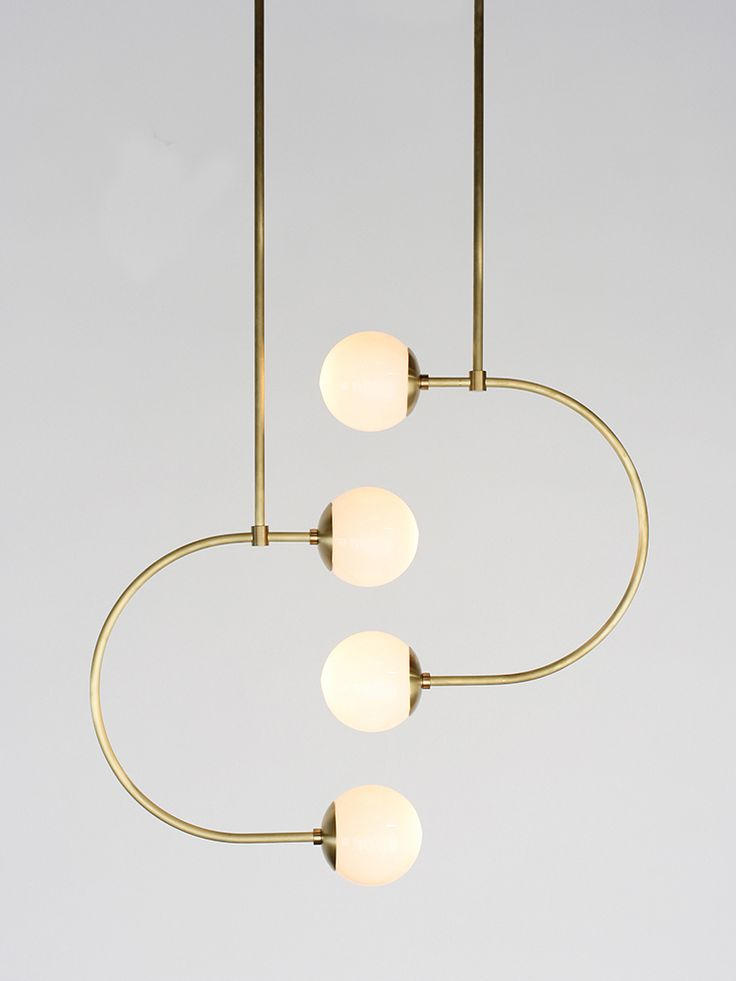 The C Light Collection is made from thin, metal tubing capped with glass globes. These contemporary C-shaped lights illuminate your way with playfulness and grace. When arranged with other C Lights, the brass tubes curve around one another and align at their glowing orbs, creating drama and tension (the good kinds).