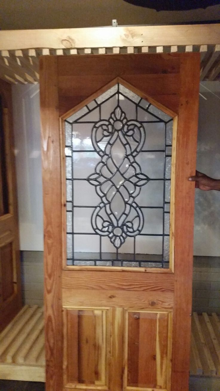 New  front door with triangular top and stained glass.