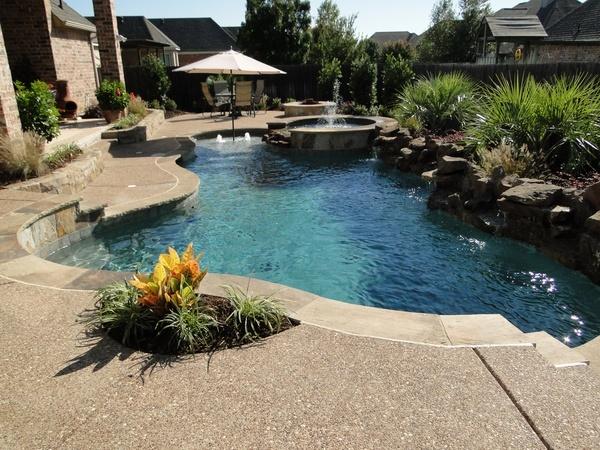 freeform play pool like the tanning ledge with umbrella sleeve
