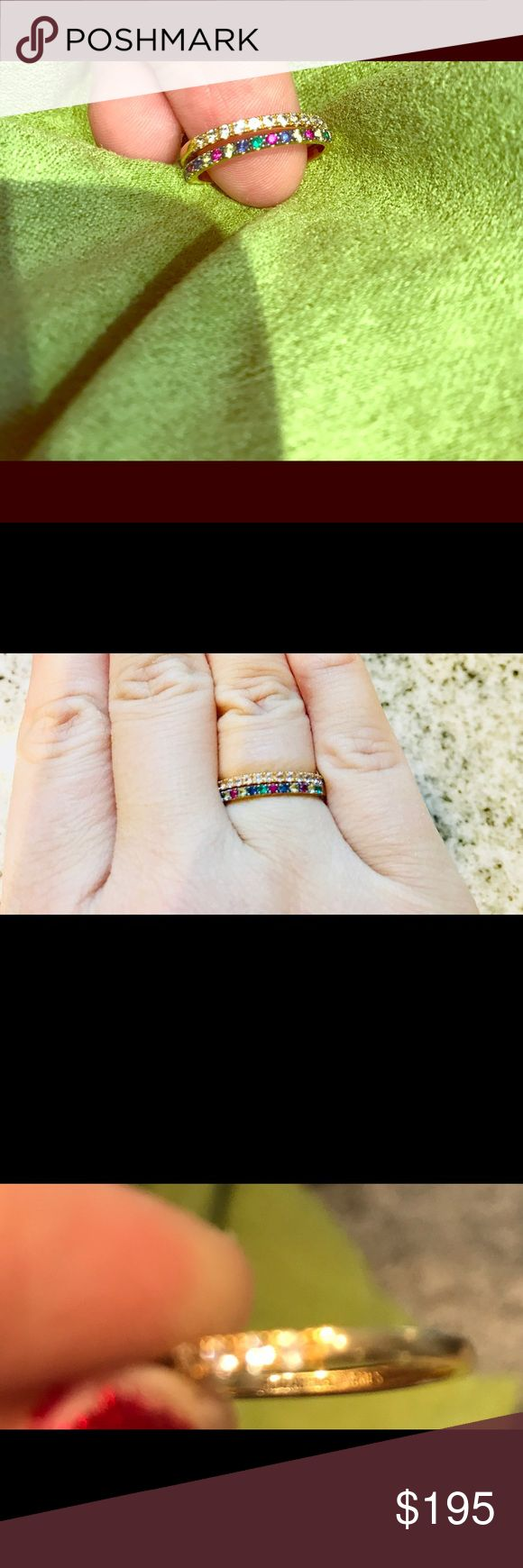 Elizabeth and James Sapphire & white topaz rings 100% authentic Elizabeth and James ring set. Yes, you get both! Can be worn separately or together. Gold plated with colored sapphires and the other is gold plated with white topaz stones. The size is about a 6-6.5. Worn once. Have very minor scratches on gold. Each ring has Elizabeth and James logo on inside of band. Elizabeth and James Jewelry Rings