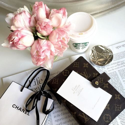 Louis Vuitton Monogram agenda cover, Chanel shopping bag, and Starbucks coffee