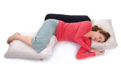 The Four Bs (bolsters, blankets, blocks, and belts) help open the body to deep relaxation.