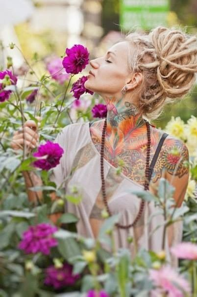 Smelling the flowers... awesome dreads & tattoos! maybe 2014?