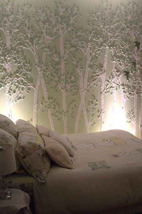 Trees are stenciled on the wall with plaster. What a cool effect!