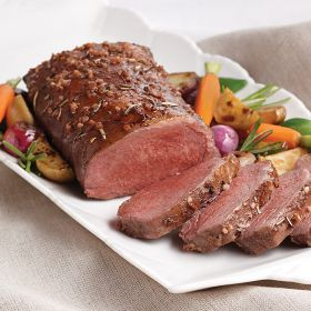 Omaha Steaks (18 oz.) Marinated Lamb Loin Roast | Whether it's a special occasion, a holiday or just a family dinner, our Marinated Lamb Loin with #1StepRapidRoast makes it easy to enjoy a gourmet meal without the mess and hassle of spending the day in the kitchen preparing it. Featuring the crown jewel of the lamb, this boneless rack is marinated Mediterranean style with olive oil, garlic, rosemary and white wine to create a savory meal that will tickle your taste buds with delight.