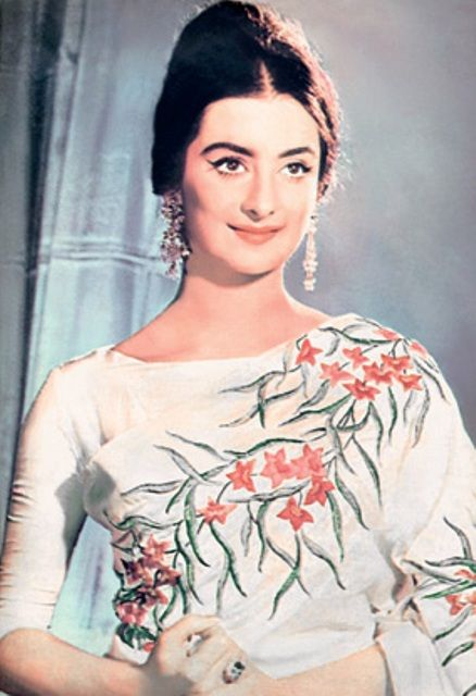 Sixties Indian Style. White saris (often with painted motifs), boat neck blouses, dramatic eyes and big (sort of) hair styles.
