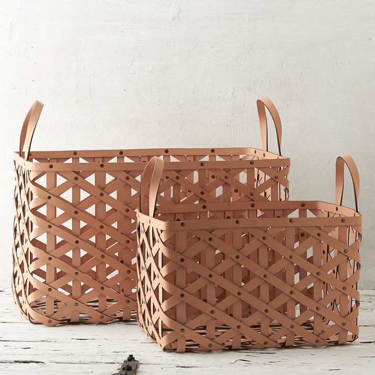 "Designed and crafted exclusively for terrain, this diamond-weave leather basket with grommet details offers a luxurious and practical solution to storage around the house.- A terrain exclusive- Leather, metal grommets- Wipe clean with damp cloth- ImportedSmall: 17.5""H, 19""W, 12.5""LLarge: 22""H, 26""W, 16.5""L"