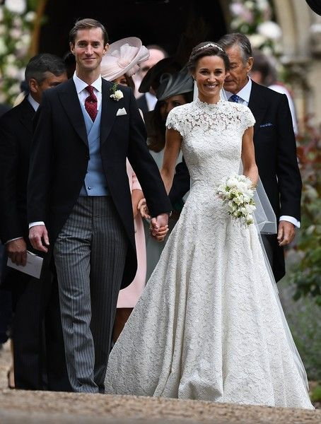 Pippa Middleton Photos Photos - Pippa Middleton (R) and her new husband James Matthews leave St Mark's Church in Englefield, west of London, on May 20, 2017 following their wedding ceremony..After turning heads at her sister Kate's wedding to Prince William, Pippa Middleton graduated from bridesmaid to bride on Saturday at a star-studded wedding in an English country church. The 33-year-old married financier James Matthews, 41, at a ceremony attended by the royal couple and tennis star Roger…