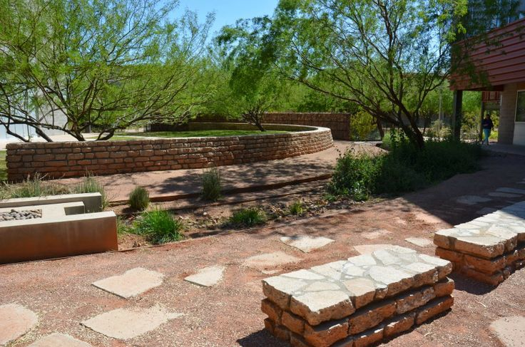 """Tour of Sustainable Southwestern Landscapes: Part 1 - Broken concrete """"urbanite"""" re-purposed to create step stones, benches and a retaining walls."""