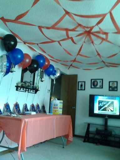 Spiderman birthday party.  The web made of streamers is just so fantastic. Great idea for lessons about insects too!