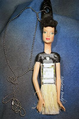 Marlene Brady.  Paintbrush necklace made with doll head & arms, Apoxi Sculpt and acrylic paint
