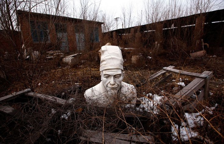 A bust of Confucius rests at an abandoned workshop in the town of Dangcheng in Quyang county, 240 km (150 miles) southwest of Beijing, on December 7, 2011.