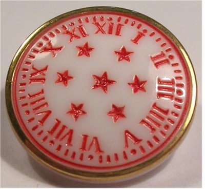 Milk Glass  . . .   Vintage milk glass button with red roman numerals.