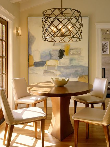 While an antique brass chandelier and a custom table give the breakfast area a sophisticated look, the chairs are upholstered in kid-friendly vinyl for easy cleaning.