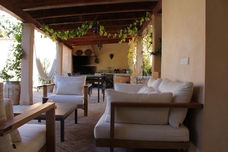 Comfortable lounge set under the porch of Villa Emilia in Sóller, Mallorca. www.sollersecrets.com