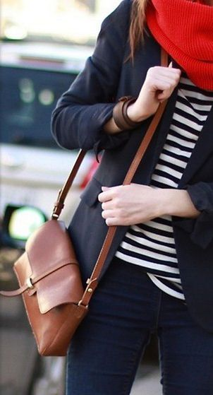 Striped navy blue and white tee. Blue blazer, jeans, brown handbag with a red scarf. Winter outfit easily to copy.