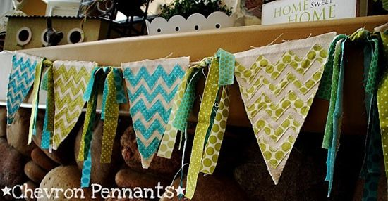 fabric pennant banner. i like the strips tied between the panels. great use of scrap material