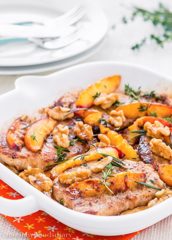 Grilled Pork Chops with Peaches and Walnuts - The easiest and most amazing pork chops ever…ready in 20 minutes! It doesn't get better than that. Just peachy! http://mommyhoodsdiary.com