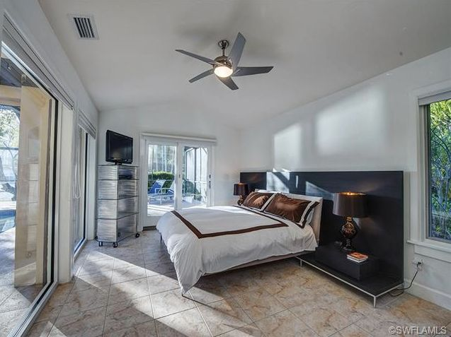 Contemporary master bedroom - white and brown in Park Shore, Naples