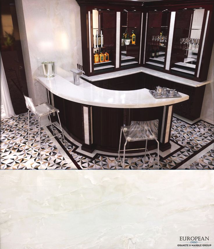 This bar design accentuates the Pure White Onyx countertops by contrasting with dark wood details. Onyx is translucent and can be lit from behind or beneath to showcase its crystalline beauty. In this case, the stone has a super polished to add a brilliant reflective shine. Find out more here: http://www.egmcorp.com/onyx/white-onyx-super