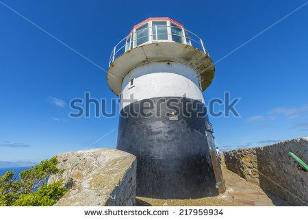 http://www.shutterstock.com/pic-217959934/stock-photo-cape-point-is-located-near-the-city-of-cape-town-south-africa-the-peninsula-has-towering-rock.html?src=pp-same_artist-217959937-2 Cape Point Is Located Near The City Of Cape Town, South Africa. The Peninsula Has Towering Rock Cliffs And Lighthouse That Overlook The Beautiful Ocean View. A Tourism And Travel Hot Spot. Stock Photo 217959934 : Shutterstock