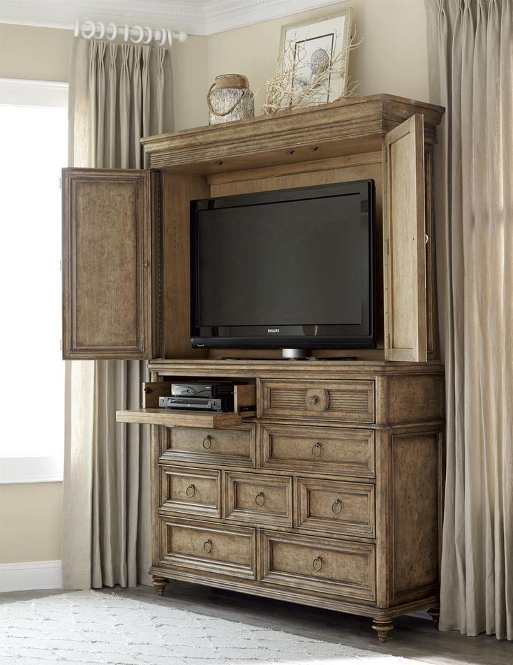 "This grand armoire offers great style and function to a bedroom or living room entertainment space. The top of the chest can accommodate a flat-panel TV up to 50"". The top left-side drawer has a drop-front for easy use with an electronic component."