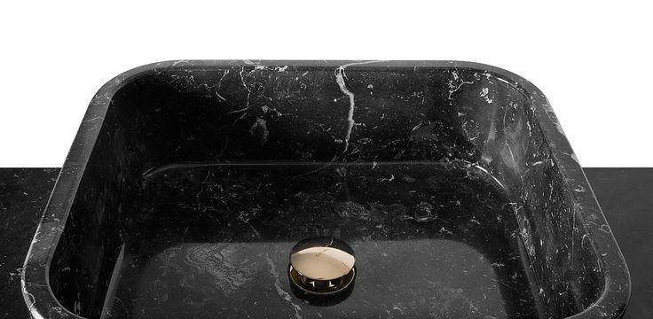 Metropolitan nero marquina washbasin pays a tribute to the Metropolitan Museum of Art in the 5th Avenue of NYC.  This luxury design piece has a wood body and the front of the cupboard is in cut mirror.