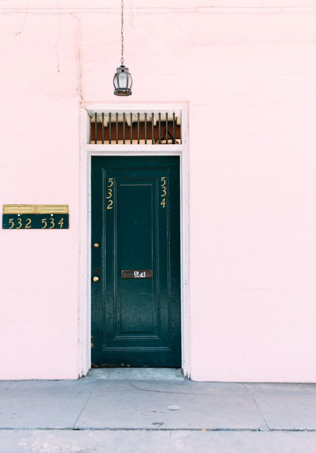 pink building, black door- yes, please. It's French Quarter address is icing on the cake