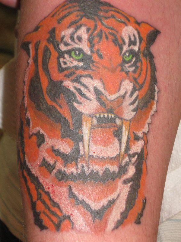 20 Tiger Teeth Tattoos Ideas And Designs