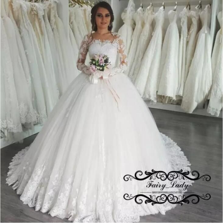 Vestido De Noiva 2018 Sheer Lace Wedding Dresses With Long Sleeves White  Puffy Ball Gown Appliques Beads Plus Size Women Bridal Dress Gowns 185d6ae02fb3