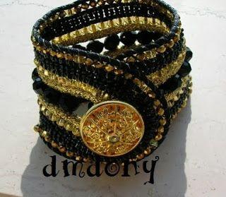 bracciale con bottone e perline oro e nero
