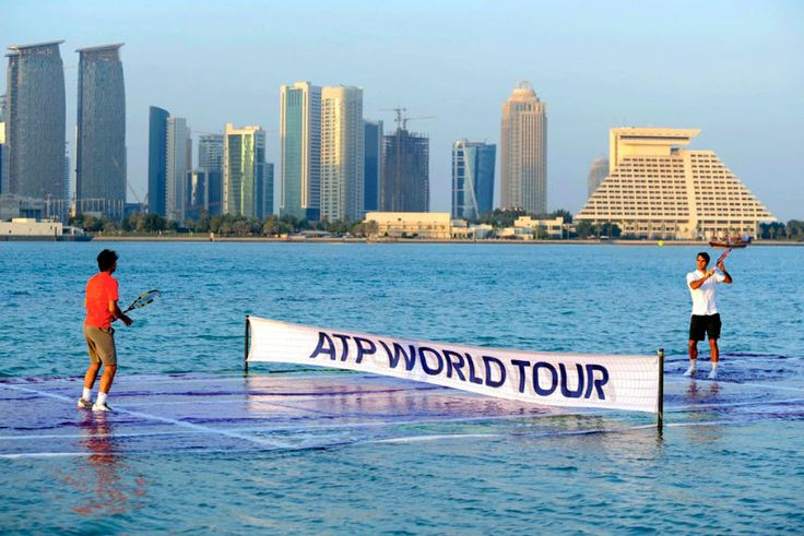 [We're not entirely sure how this works, but tennis stars Rafael Nadal and Roger Federer play on an aquatic tennis court in Doha, Qatar today to promote the Qatar ATP Open Tennis tournament. Image via AP]