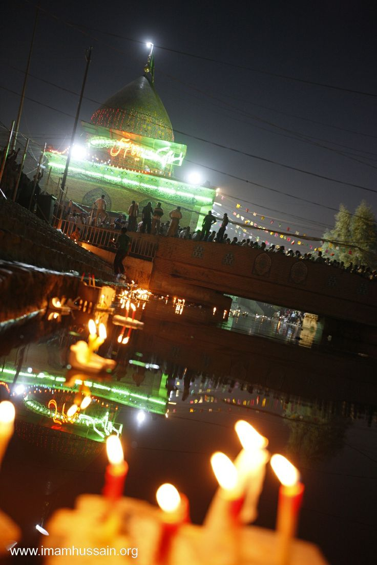 Candles in the river Euphrates on the birthday of Imam Mahdi.. People often write notes to the Hidden Imam and put them with the candles to flow in the Euphrates