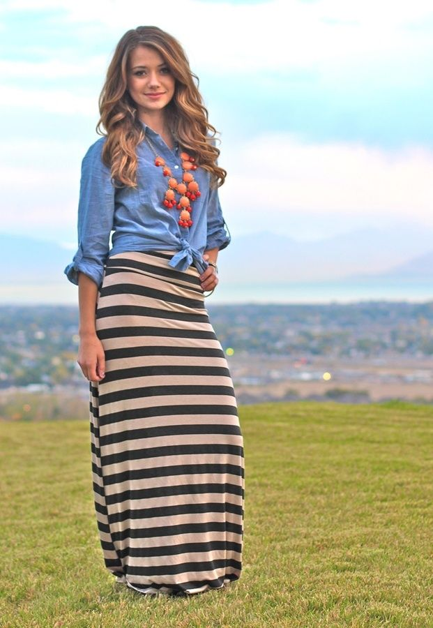 Striped maxi skirt, tied button up blouse, chunky necklace.