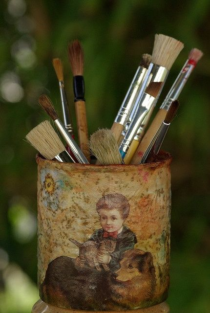 an altered tin can as storage for brushes or pencils...so pretty