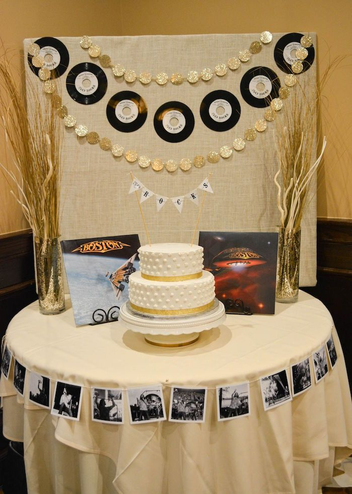 Dried Plants Arranged In Two Sparkling Vases Placed On Either Side Of A White Cake With Gold Details Vinyl Records And Boston Albums 60th Birthday