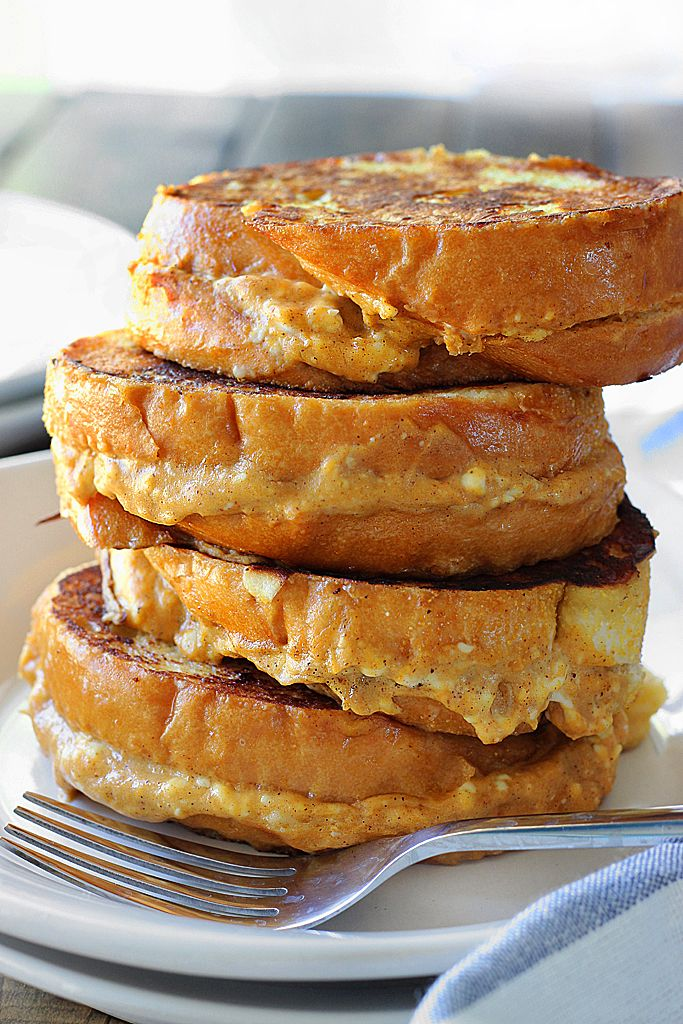 This pumpkin cream cheese french toast is a fun way to celebrate pumpkin season! With a cheesy pumpkin filling and all french toast flavors you love.