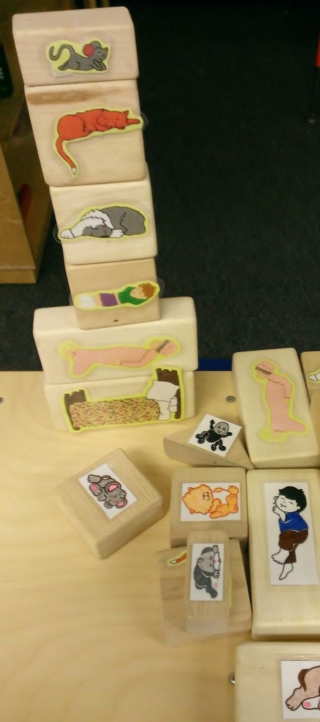 The Napping House blocks. Print outs of the story characters and tapped onto our wood blocks.
