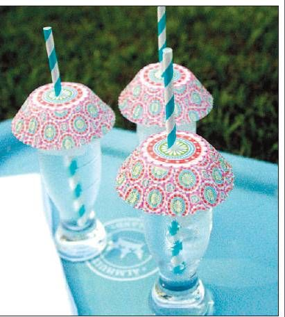 Keep bugs out of drinks.  Cut a little slit in cupcake liner, add a straw, cover glass. simple, inexpensive.  could even put names on liners