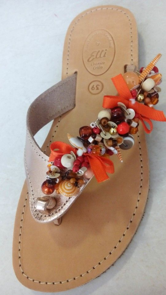 Handmade gold leather sandals decorated with pearls designed by Elli lyraraki