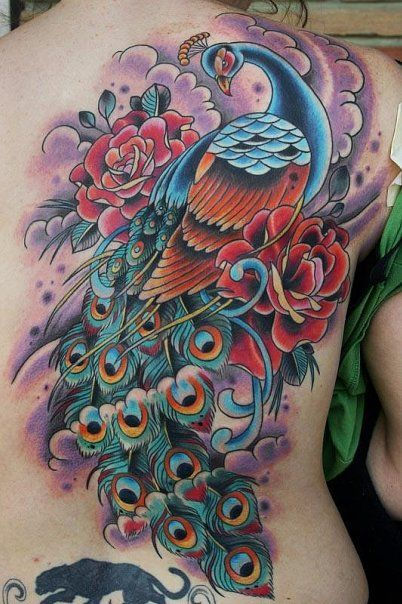 This beautiful old school tattoo design of a peacock bird includes roses to add the meaning of passion