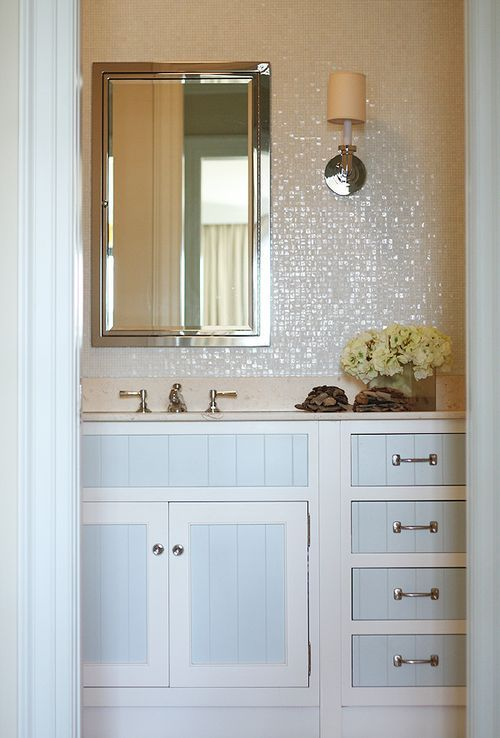 love the mother of pearl tile and two toned cabinetry