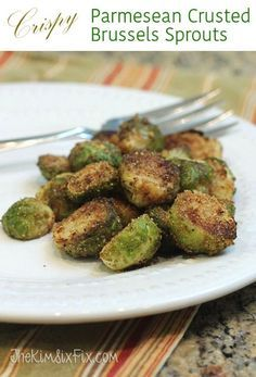 Crispy Parmesan Crusted Brussels Sprouts: An easy recipe since you par-bake the sprouts in the oven and finish them on the stove. No need to watch them they entire time. The crispy bread cumbs and salty cheese is a perfect addition to the soft savory Brussels Sprouts. #TheKimSixFix www.TheKimSixFix.com