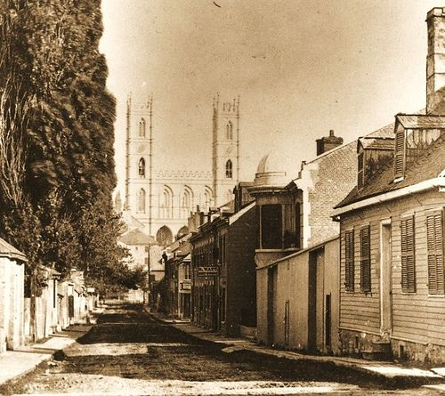 Montreal 1860. St. Urbain> South since Lagauchetiere Street / W.Notman.    This document comes from the McCord Museum Archives.  1860, a beautiful view of the Saint-Urbain Street looking south. Dirt road lined with poplars Lombardy, boardwalks, residences, some shops with one or two floors.