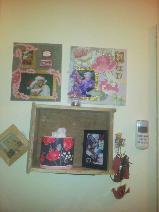 Made a shelf out of a drawer. Hung it with self tapping  hooks. I made those canvsses too. Using scrap booking paper.