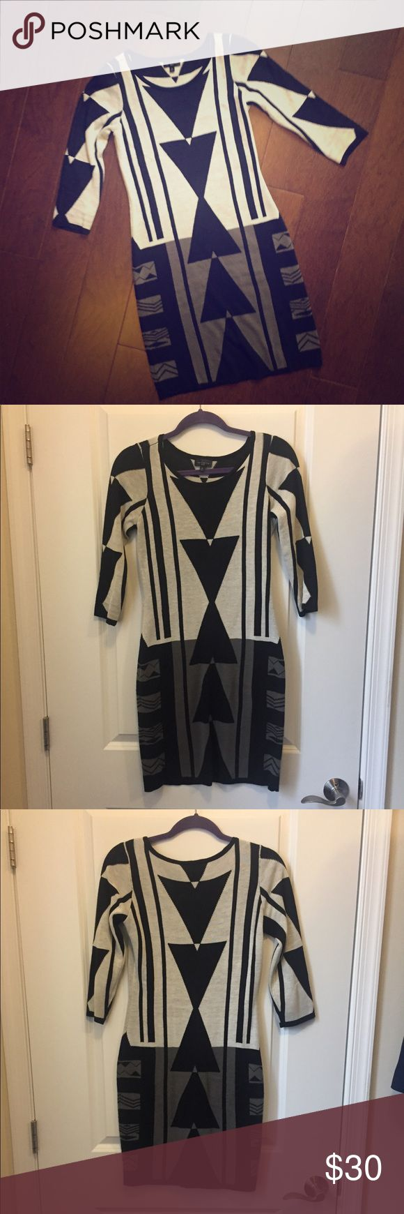 Aztec Print Sweater Dress Really cute and eye catching Aztec Print Dress.  Colors: black, white, and gray.  The length is 34.5in. Gently worn (minimal sweater fuzz).  Good condition. The Limited Dresses Midi