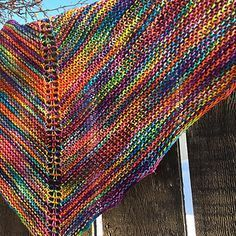 Marilyn's Easy Rainbow Shawl. Very easy to knit, use any yarn, and knit till you have the size of shawl you want. Free pattern at Ravelry.